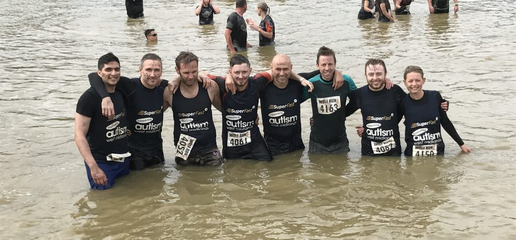 A group of Superfast employees fundraising during a Mud Run for Autism West Midlands